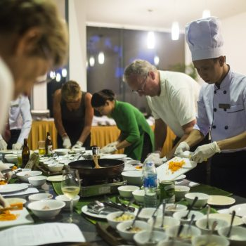 Tourists learn to cook vietnamese food in Cooking Class