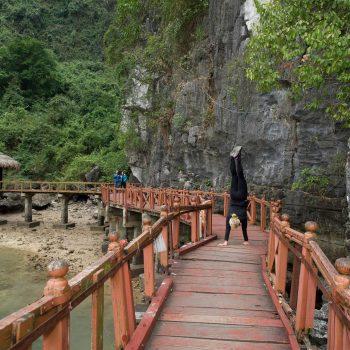 Yoga on bridge in Halong Bay