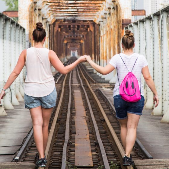 Tourist walking alongside abandoned rails in Hanoi