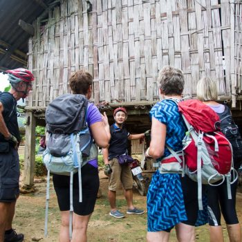 Tourist finally arrives at traditional village homestay after a long day of trekking
